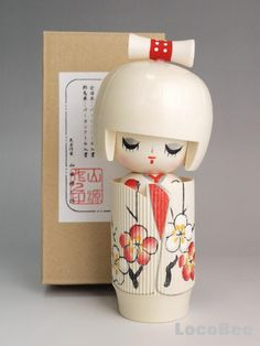 """This is a Japanese Sosaku Kokeshi """"Doll desing by Yamada Genji. The tittle is Taishun, meaning wait a spring."""""""