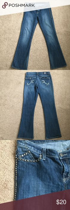 Rock & Republic Jeans Kassandra (Boot Cut)  Midrise sits above the hip Bootcut flares slightly at the knee Zipper fly Rock & Republic Jeans Boot Cut
