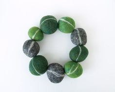 Felted stones in mossy colors.  By Fariyfolk on Etsy.  $9.00  They also sell a kit if you want to DIY.
