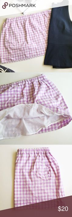 J.Crew Gingham Skirt Lavender gingham skirt from J.Crew factory. Elastic waist, fully lined, with pockets! Worn twice. Perfect for summer! 100% cotton. Waist measures 17 inches across, but it is elastic waist so it is really stretchy and could fit a larger size if needed. Bottom hem measures 26 inches across. Length measures 17 1/2 inches from waist to hem. J. Crew Skirts