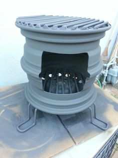 Repurposed car rim fireplace www whitedoverestoration com Rim Fire Pit, Fire Pit Grill, Fire Pit Backyard, Pliage Tole, Diy Wood Stove, Rims For Cars, Car Rims, Outdoor Stove, Diy Grill