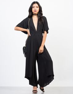 Dinner date or girls' night out? This black Flowy Chiffon Jumpsuit will have you ditch your little black dresses. Pair this jumpsuit with some strappy heels and accessorize with a simple choker for the ultimate one-piece wonder look.