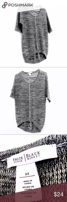 White House Black Market Short Sleeve Sweater Like new short sleeve sweater, woven with black and white threads together. The front weave is looser than the back, making the front a little see through. Longer in the back. Sleeves hit just above the elbows. Looks great with leggings or skinny jeans! White House Black Market Sweaters Crew & Scoop Necks