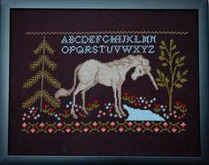 Tiny Modernist Last Unicorn, The - Cross Stitch Pattern. Model stitched on 14 Ct. Black Aida with DMC floss. Stitch Count: 98x169. Color chart.