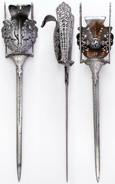 Indian katar, from Thanjavur (formerly Tanjore) in South India, with prominent cobra and yali's (leogryphs), 16th century, L. 22 1/4 in. (56.5 cm); W. 4 1/2 in. (11.4 cm); Wt. 32.9 oz. (932.7 g), Met Museum, Bequest of George C. Stone, 1935.