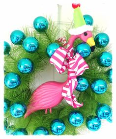 Blue Christmas Ball Wreath with Flamingo. Beachy Christmas decor, so cute! Coastal Christmas Decor, Nautical Christmas, Blue Christmas, Christmas In July, Christmas Wreaths, Christmas Bulbs, Christmas Crafts, Holiday Decor, Christmas Flamingo