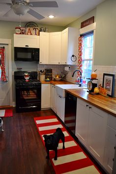 NewlyWoodwards - New kitchen red and white and silver sage, black appliances