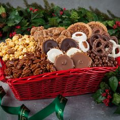 In the South, we like to wish friends and family Merry Christmas in a really big way. This beautiful, red painted basket with wooden side handles is filled with our World Famous Pralines®, Assorted Chocolate Bear Claws®, Glazed Pecans, Chocolate Peanuts, Mini Pecan Pies, sweet and crunchy Caramel Pecan Popcorn, Divinity and Chocolate Dipped Pretzels.