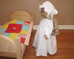 A perfect doll nightgown and nightcap for sleeping in the pioneer days. This 18 cotton nightgown closes with 2 buttons in the front . The