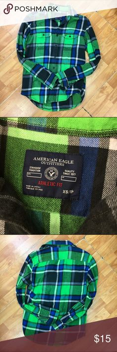 American Eagle Outfitters Athletic Fit Flannel XS American Eagle Outfitters Athletic Fit Flannel Plaid Shirt Mens XS  Has wash wear and fade.  Missing button on one cuff.  Green, blue, black and white plaid.  #athleticfit #plaid #flannel #americaneagle #shirt #buttonfront #plannelflaid #green #blue #winteriscoming #winter #fall #itsfallyall American Eagle Outfitters Shirts Casual Button Down Shirts