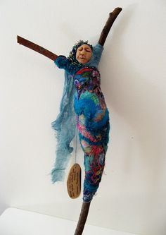 """Message stick doll : wrapped stick armature, with polymer clay head, sari silk ribbons, bead embroidery, with meassage hand written on a wooden tag, """"No one can make you feel inferior without your consent. (Eleanor Roosevelt) ."""