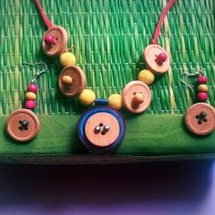Handmade jewellery using beads buttons and quilling paper - message for enquires