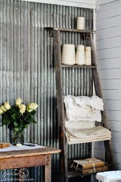 Turn an old ladder into a cool storage solution by simply leaning it against the wall. Drape some plush blankets over the rungs for an instant no-fuss wall hanging. If the ladder has steps instead, add some Mason jars for a country touch.