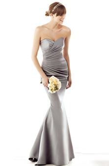 Impression Bridal. Mermaid shape dress with asymmetrical pleated bodice.