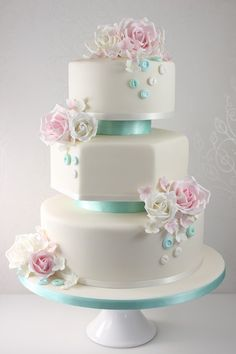 pink and tiffany blue rose button wedding cake. change blue to dusty pink, and change buttons to pearls draped over cake Pretty Wedding Cakes, Floral Wedding Cakes, Elegant Wedding Cakes, Wedding Cakes With Flowers, Wedding Cake Designs, Pretty Cakes, Wedding Cake Toppers, Beautiful Cakes, Flower Cakes