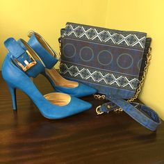 Blue heels Brand new with out tags. Only tried on. Small scuff on the back of one shoe(photo posted). I have a matching purse in the photo in my closet for sale. I will bundle them together for $35. Shoes Heels
