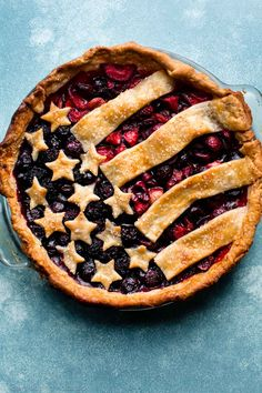 How to make a patriotic American flag pie for 4th of July and all summer picnics! It's delicious with homemade pie crust and mixed berry pie filling!
