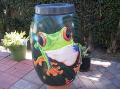 Rain barrels - great idea ... repaint the old rain barrel instead of dumping it and buying a new expensive one