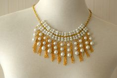 This easy but elegant pearl and gold chain dangle necklace is finished! How adorable it is!
