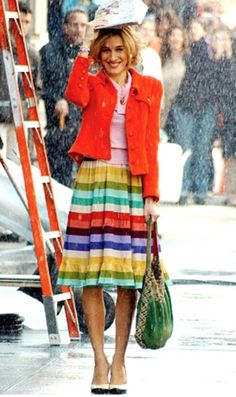"""Rainbow-striped Nanette Lepore dress (yup--that's a dress, not a skirt!), red vintage Chanel jacket, pink Club Monaco sweater and black and white Narciso Rodriguez spectator pumps from """"Sex and the City"""" episode """"I Heart NY"""""""