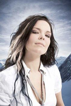 Anette Olzon. Former singer of Nightwish. Again: blonde streak with dark hair.