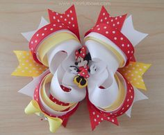 This is what we call an adorable, colorful and loopy hair bow! Inspired on Minnie Mouse colors, this hair bow has a combination of red, yellow and white ribbons which makes it a very colorful one. Thi
