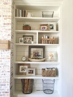 Built-in bookshelves styling and decor, shiplap, whitewash brick fireplace, rustic mantle, baskets
