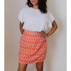 Skirt Orange with a very light blue-grayish tone. Has side pockets. 100% polyester Annabella Skirts