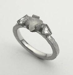 Todd Pownell: , Palladium ring with 0.60CT natural triangular uncut diamond and two trillion inverse set diamonds (0.26TCW)set into darkened palladium bezels. 2mm hammered 950 palladium shank. Size 5.5 (May be sized to fit).