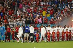 Real Madrid and Manchester United players take the field during International Champions Cup action at Hard Rock Stadium in Miami Gardens Fla on. Td Garden, In China, Real Madrid, Manchester United Stadium, Seoul, International Champions Cup, Miami Gardens, Hard Rock, Budapest