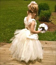 Jenn loves this dress for MJ :: bohemian flower girl | Peacock-inspired flower girl dress with matching headband:
