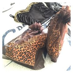 Leopard print Heel less bootie These are a size 10. I got them from Lola Shoetique, they have been worn about five or six times. I absolutely love these shoes. They have spiced up many outfits. They are a show stopper! ALBA Shoes Ankle Boots & Booties