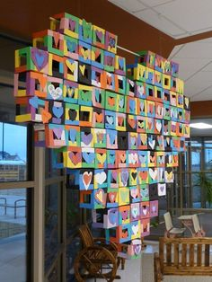 Paper cubes hot glued together as a collaborative piece for Valentine's Day. Wonderful idea for a collective group of a wide age group. Paper cubes hot glued together make a great display! I like this idea for Art Club or NAHS members to collaborate on in Group Art Projects, School Art Projects, Collaborative Art Projects For Kids, Collaborative Mural, Arte Elemental, Paper Cube, Ecole Art, Math Art, Art Lessons Elementary