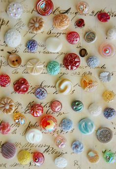 Colourful vintage glass buttons!  At Jeffrey's Antique Gallery we have a dealer who specializes in buttons just like this!  Come visit us soon! https://www.facebook.com/jeffreysantique