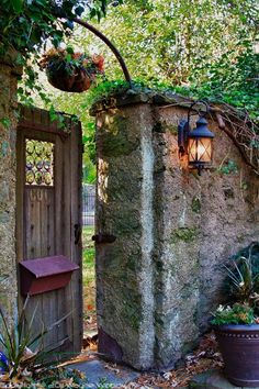 Love this rustic door and stone wall with arch!!