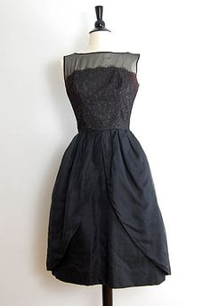 Reverie Dress    Price: $128.00    Vintage 1950s formal dress with illusion top. Lace has a slight maroon tint of color. The skirt is my favorite! It splits off into two parts, so chic!
