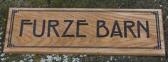 A beautiful oak sign created using the font Rennie Mackintosh  in upper case. The border is B214.   ref - 1110.LW.024 www.sign-maker.net/wooden/oak-carved-signs.html