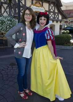 Tina Fey poses with Snow White in the Germany pavilion at Epcot in Lake Buena Vista, Fla.  Epcot is one of four theme parks at the Walt Disney World Resort.