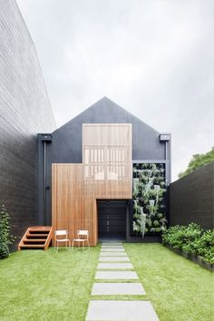 The family lounge opens up to the rear courtyard, bounded by a garage and sleepout on the opposite side.
