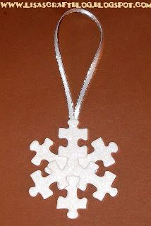 Mega•Crafty: Christmas - I love this jigsaw snowflake :) I was thinking I could cover it in fluffy  stuff and white glitter