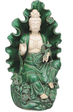 """A Dehua figure """"Guanyin on a lotus throne"""" China, late Qing-dynasty (1644-1911). Bisque porcelain, the most parts with green glaze. Seated figure of Bodhisattva Guanyin on a magnificent lotus throne, a large lotus leaf working as a halo. The left hand holding a ruyi-sceptre. Dehua seal and artist""""s mark."""