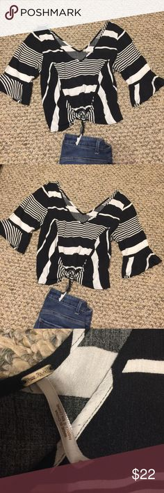 "Free People cropped white black blouse ruffle S FP ruffle sleeves cropped with knot blouse . Barely used. EUC. Length 20"". Very trendy ! No defects. Great with white Hi Rise jeans or shorts. Free People Tops Blouses"