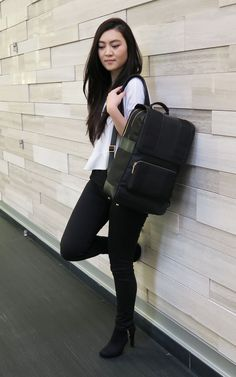 Black and white classic - This roomy laptop backpack from Arden Cove has got you covered! https://ardencove.com/products/the-daily-laptop-backpack