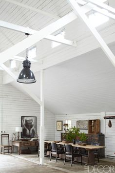 In the Art Barn, a 17th-century Swedish farm table is surrounded by circa-1930 Swedish armchairs; the Spanish desk is late 18th century, the cabinet is 19th century, the speed bag is antique, and the photograph is by an unknown artist.