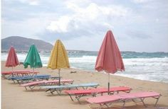 i either want to go here. or recreate this dreamy pastel chair umbrella situation on the beach at home.