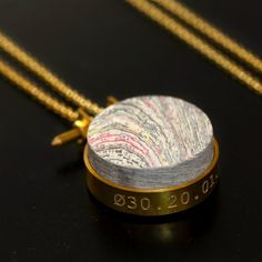 Fancy - Pressed Newspaper Necklace by Mint, for any date. I want it I want it.