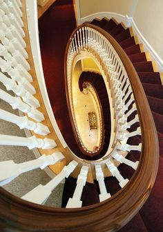 Architect Dell Mitchell designed the graceful, oval-shaped staircase.