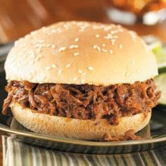 Slow Cooker BBQ Beef Sandwiches  2 cups ketchup  1 medium onion, chopped  1/4 cup cider vinegar  1/4 cup molasses  2 tablespoons Worcestershire sauce  2 garlic cloves, minced  1/2 teaspoon salt  1/2 teaspoon ground mustard  1/2 teaspoon pepper  1/4 teaspoon garlic powder  1/4 teaspoon crushed red pepper flakes  1 boneless beef chuck roast (3 pounds)  14 sesame seed hamburger buns, split