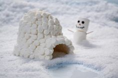 Marshmallow igloo with snowman. Would be cute on top of a cake!