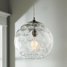 """This Young House Love exclusive features a honeycomb pattern they love. Use this clear glass pendant above a kitchen sink or group several above an island for a bright clean style. 100 watt max medium base socket. Comes with 9' of clear pendant cord and 5"""" round chrome canopy. (12""""Hx10.5""""W)"""